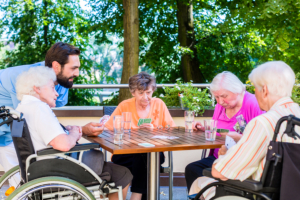caregiver and group of seniors